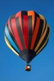 Hot air balloon, colorful aerostat on clear blue sky Stock Photos