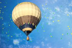 Hot-air balloon with colorful balloons in the blue sky royalty free stock image