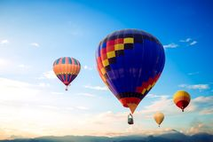 Hot air balloon. Colorful hot air balloon over mountain on sky sunset , vintage and retro filter effect style. balloon carnival in Thailand Stock Image