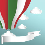 Hot air balloon in the colors of the flag of Italy. Clouds with hot air balloon from paper and white banner on blue background Illustration.nAir balloon in the Royalty Free Stock Image