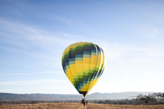 Hot air balloon in countryside