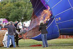 Hot air balloon crew flame envelope Stock Photography