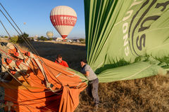 Hot air balloon is deflated after landing in the morning. Cappadocia. Turkey Stock Photos