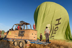 Hot air balloon is deflated after landing in the morning. Cappadocia. Turkey Stock Image