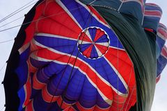 The end of the flight. Ballooning in New Zealand. Hot air balloon deflating producing some interesting shapes and vivid colours. Seeing the inside of balloon is royalty free stock photography