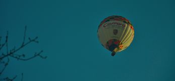 hot air balloon drifting in the wind Stock Photo