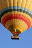 A hot air balloon during an early morning flight near Goreme in the Cappadocia region of Turkey. Stock Image