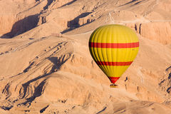 Hot air balloon in Egypt. Hot air balloon flying over the Valley of the Kings, Egypt stock photo