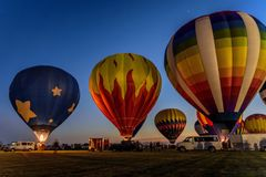 Hot air balloon festival at night. Hot air balloons glowing in the night sky in Harvard, IL Stock Photography