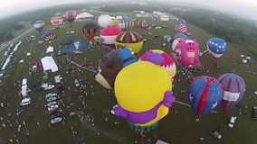 Hot air balloon festival seen from above stock video