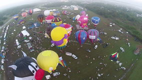 Hot air balloon festival seen from above stock footage