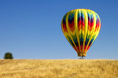 Hot Air Balloon in a Field Stock Photo