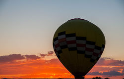 Hot Air Balloon Filling with setting sun Royalty Free Stock Photos