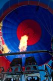 HOT AIR BALLOON. FLAME from double gas burner BLOWING UP HOT AIR BALLOON Royalty Free Stock Photo
