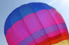 Hot air balloon flies in sky blue Stock Image