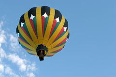 Hot air balloon in flight. And firing the burner stock photography