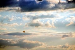 Hot air balloon in flight against dramatic cloudy sky stock images
