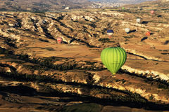 Hot air balloon flight in Cappadocia, Turkey. Hot air balloons flying over Cappadocia in Goreme, Turkey. Hot air ballooning is very popular thanks to the Royalty Free Stock Photos