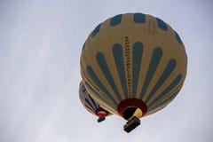 Hot air balloon flight in Cappadocia, Turkey. Goreme, Turkey - April 6: Hot air balloons flying over Cappadocia in Goreme, Turkey on April 6, 2014. The hot air Stock Photos