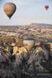 Hot air balloon flight in Cappadocia, Turkey. Goreme, Turkey - April 6: Hot air balloons flying over Cappadocia in Goreme, Turkey on April 6, 2014. The hot air Royalty Free Stock Photo