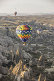 Hot air balloon flight in Cappadocia, Turkey. Goreme, Turkey - April 6: Hot air balloons flying over Cappadocia in Goreme, Turkey on April 6, 2014. The hot air Royalty Free Stock Photos