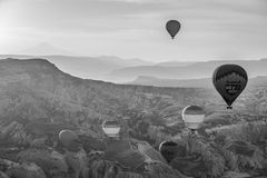 Hot air balloon flight in Cappadocia, Turkey. Goreme, Turkey - April 6: Hot air balloons flying over Cappadocia in Goreme, Turkey on April 6, 2014. The hot air Stock Images