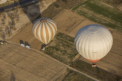 Hot air balloon flight in Cappadocia, Turkey. Goreme, Turkey - April 6: Hot air balloons flying over Cappadocia in Goreme, Turkey on April 6, 2014. The hot air Stock Image