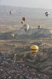 Hot air balloon flight in Cappadocia, Turkey. Goreme, Turkey - April 6: Hot air balloons flying over Cappadocia in Goreme, Turkey on April 6, 2014. The hot air Royalty Free Stock Images