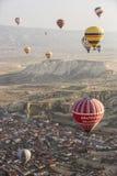 Hot air balloon flight in Cappadocia, Turkey. Goreme, Turkey - April 6: Hot air balloons flying over Cappadocia in Goreme, Turkey on April 6, 2014. The hot air Royalty Free Stock Photography