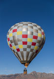 Hot air balloon in flight Royalty Free Stock Photography