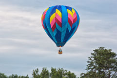 Hot air balloon in flight with gas burning Royalty Free Stock Photography