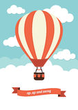 Hot Air Balloon. Floating in a cloudy sky Royalty Free Stock Photo