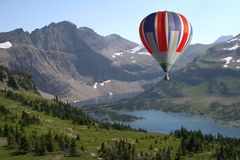 Hot Air Balloon floating near the mountains Royalty Free Stock Image