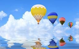 Hot air balloon floating in the sky. Over the lake Royalty Free Stock Photos