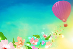 Hot air balloon with flowers flying from Stock Photography