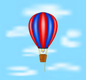 Hot air balloon flying on blue sky Stock Photography