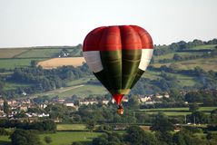 Hot air balloon flying far over Bristol city in England Royalty Free Stock Photos
