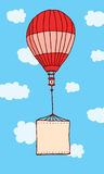 Hot air balloon flying with hanging blank sign Royalty Free Stock Photos
