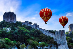 Hot Air Balloon flying Old fortress Stock Photos