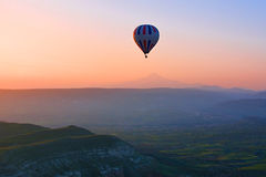 Hot air balloon flying over amazing landscape at sunrise, Cappad Royalty Free Stock Images