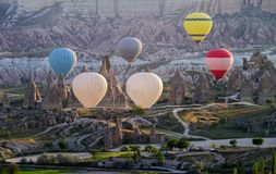 Hot air balloon flying over amazing landscape at sunrise, Cappadocia stock image