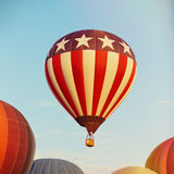 Hot air balloon flying over blue sky Royalty Free Stock Photography