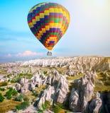 Hot air balloon flying over Cappadocia, Turkey stock photo