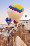 Hot air balloon flying over Cappadocia Turkey Stock Photography