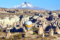 Hot air balloon flying over Cappadocia. Royalty Free Stock Image