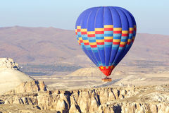 Hot air balloon flying over Cappadocia. Stock Photography