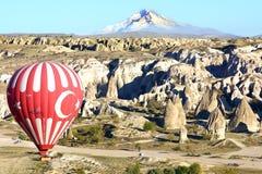 Hot air balloon flying over Cappadocia. Royalty Free Stock Photography