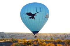 Hot air balloon flying over Cappadocia. Royalty Free Stock Photo