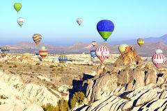 Hot air balloon flying over Cappadocia. Royalty Free Stock Photo