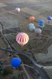 Hot air balloon flying over Cappadocia Stock Image